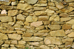 Stonework. A fragment of a stone wall in the Caucasian village Stock Photo
