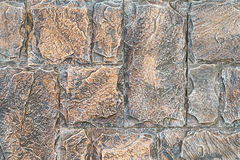 Stonework with asymmetry. Close-up bright vintage bricks wall background. stone wall for background texture. Royalty Free Stock Photo