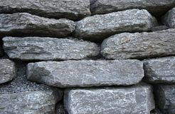 Stonework background. Gray flat stones and gravel stock images