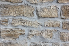 Stonework of the old gray limestone texture Royalty Free Stock Image