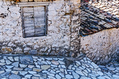 Stonework in Old Style Greek Village, Greece. Detail of different stonework techniques; stone and mortar wall house and hut walls, flagstone paving and Royalty Free Stock Images