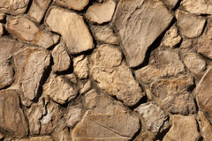 Stonework. Random size of flat-face stone cut and stacked to make a wall Stock Image