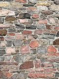 Stonework in rows with mortar in many colors. Stonework in rows with mortar in browns reds and grays Royalty Free Stock Image
