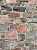 Stonework in rows with mortar in many colors. Stonework in rows with mortar in reds and grays Stock Images