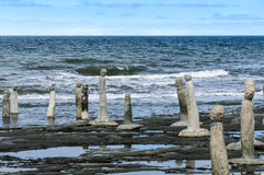 Stonework statues leading into the St. Laurence River Stock Photo