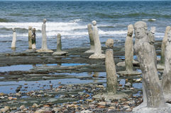 Stonework statues leading into the St. Laurence River. The Great Gathering - stonework statues leading into the St. Laurence River  in Sainte-Flavie, Gaspesia Royalty Free Stock Photography
