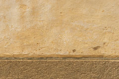 Stonework texture. Stonework plaster with two different materials closeup Royalty Free Stock Image