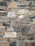 Stonework wall in rows with mortar in many colors. Stonework wall in rows with mortar in reds, browns and grays Stock Image
