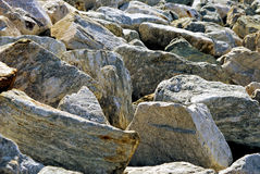 Stoney background. A pile of massive rocks fill the image, suitable for a background Royalty Free Stock Photo