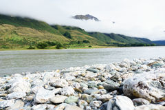 Stoney Dart River with low cloud along hills on other side Stock Images