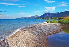 The stoney shores of Nikolaiika Beach on the Corinthian Gulf in Greece. The beautiful stoney shores of Nikolaiika Beach on the Corinthian Gulf in Greece Stock Photography