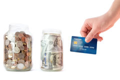 Stoni con le monete ed i soldi, carta di credito a disposizione Fotografia Stock Libera da Diritti