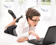 Stonished. Astonished young businesswoman with laptop on the floor stock images