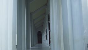 Stony arched corridor architecture in ancient building design. Long baroque arcade colonnade exterior. Antique design. With corridor archway perspective stock footage