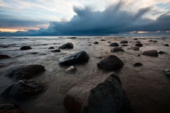 Stony Baltic Sea beach. In evening stock images