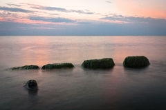 Stony Baltic Sea beach  in evening Royalty Free Stock Image