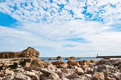 Stony beach. Sea and beautiful clouds Royalty Free Stock Image