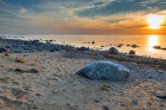 Stony beach of the Baltic Sea, sunset Stock Image