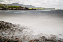 Stony Beach. Coast at the Atlantic Ocean in Ireland with beautiful rocks in the foreground royalty free stock image