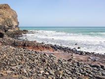 Stony beach at the coast of the Atlantic ocean Stock Photos