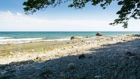 Stony beach in Lohme. Stony sunny beach in Lohme Stock Images
