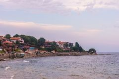 Stony beach and some red brick houses at Nesebar, Bulgaria. Stony beach and some houses at Bulgaria, Nesebar royalty free stock images