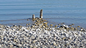 Stony beach and the water, Boden-Lake, Germany. Boden-Lake detail on the Insel Mainau royalty free stock image
