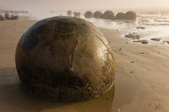 Stony boulders at Moeraki beach Royalty Free Stock Photography