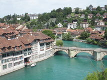 Stony bridge over clean alpine Aare river in city of Bern. BERN BERNE, SWITZERLAND, bridge over clean alpine Aare river with clean water and cityscape landscape Stock Image
