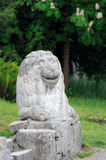 Stony chapped figure of lion at entrance to Olesko Castle Stock Photos