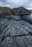Stony coast of lake closeup landscape Royalty Free Stock Photography
