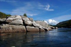 Stony coast of the mountain river. Stock Photos