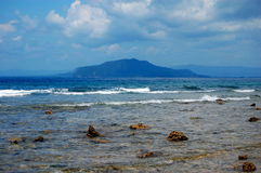 Stony coast at sea harbor, Indonesia Stock Image