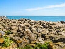 Stony coast by summer day Stock Photos