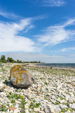 Stony coastline against scenic cloudscape Royalty Free Stock Images