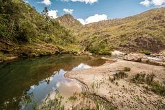 Stony creek in sunny weather. Stony creek in rural Brazil, with lush vegetation around it, on a bright sunny day stock photography