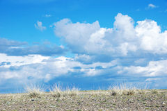 Stony desert and blue sky with clouds Royalty Free Stock Images