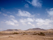 Stony desert and distant mountains Stock Photography