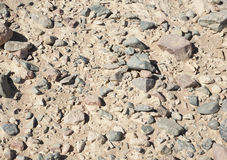 Stony desert ground background Stock Photos