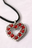 Stony heart. Isolated necklace with red stones Royalty Free Stock Photo