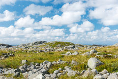 Stony landscape with blue sky with white clouds. Royalty Free Stock Photography