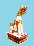 Stony lion. A golden decorated white lion standing guard on a concrete base . The art is in Lanna styled under the influence of Burma Royalty Free Stock Image