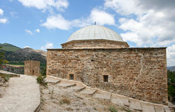 The stony medieval temple in the medieval Genoese fortress and distant mountains. Royalty Free Stock Photos