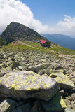 Stony mountain ridge and chalet Stock Photos