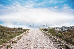 Stony path leading to cityscape Stock Images