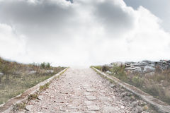 Stony path leading to horizon Stock Photography