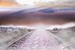 Stony path leading to horizon Royalty Free Stock Image
