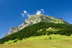 Stony peak and blue sky Stock Image