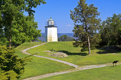 Stony Point Lighthouse Paths. Stony Point Lighthouse on a grassy knoll overlooking the Hudson River in New York State royalty free stock photos
