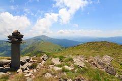 Stony post on summer mountain ridge Stock Images